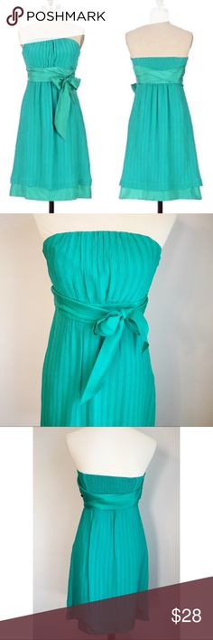 """Anthropologie Green Crepe Strapless Dress Anthropologie green silk dress by Moulinette Soeurs. This lovely empire waist green dress is strapless, with inner boning for structure and support. A gathered waistband and silk ties accent an overlay of crinkled, striped silk chiffon. Smocking at back for close fit. Perfect for Spring and Summer weddings and cocktail parties!  Approximate measurements (flat): underarm to underarm: 15""""; length: 30"""".  Worn a few times. In great shape—no rips, holes…"""