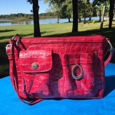 75% Off!! Brighton Magenta NEW Cross Body Bag This is dynamite! Glossy patent leather with croc imprint, a handle that is completely adjustable to become a shoulder bag, a cell phone holder on front plus an additional pocket with magnetic closure. Two interior zip pockets. Perfect condition. No scratches or stains whatsoever. It's a 10! Brighton Bags Crossbody Bags
