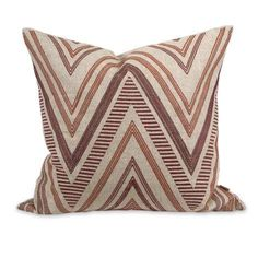 A funky chevron pattern adds warmth and interest to the Kamaria pillow that features deep red embroidered accents, a natural linen cover and down fill. Designed by Iffat Khan.