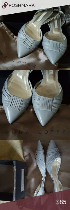 Pura Lopez wedding pumps Gorgeous baby blue (slightly gray blue)  Finest soft leather Size 40 but run small - I usually wear a 8.5 or 9 I got these shoes for my wedding then changed my dress and never wore them. I wore them at a few fittings and so the soles are scuffed a tiny bit, but these beauties are otherwise brand new.   Heel is about an inch  Made in Spain In box With dust bag and replacement heel tips I'll consider any offer Pura Lopez Spain Shoes Heels