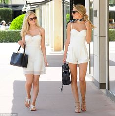 Sunning in France! Kimberley Garner, 25, enjoyed a luxury shopping trip with her pal in a strapless white play-suit on Thursday afternoon in the sunny South of France