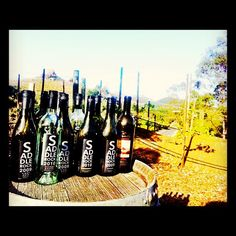 Wine bottles on a barrel