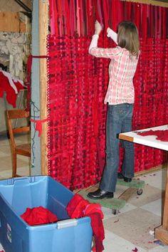 used sweaters + giant potholder loom = awesome rug