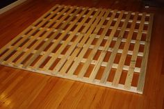 this idea is essentially just building slats to raise the mattress off the floor for an inexpensive, low-profile bed