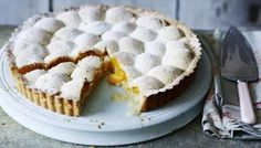 The pastry and marzipan melt over the apricot halves to make a wobbly top for this sweet, and simply delicious, fruit tart.