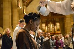 Kayla Turnipseed is baptized during the Easter Vigil March 27, 2013, at Sacred Heart Cathedral, Rochester, NY. - (Catholic Courier photo by Tamara Tirado)