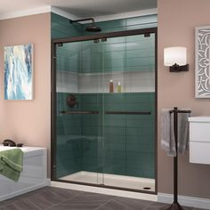 DreamLine Encore H x to W Semi-Frameless Bypass/Sliding Oil Rubbed Bronze Shower Door at Lowe's. The DreamLine Encore bypass sliding shower or tub door has a modern frameless look to make your shower the focal point of the bathroom. Shower Base, Shower Floor, Shower Enclosure, Shower Faucet, Shower Stalls, Frameless Sliding Shower Doors, Sliding Door, Door Hinges, Shower Kits