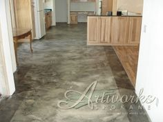 Decorative concrete overlay with a border outlining the room. Great movement and color choice!
