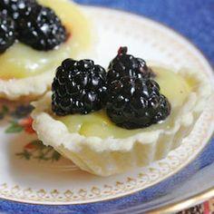 Mini lime tartlets with glazed blackberries