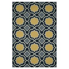Wool rug with a geometric trellis motif. Hand-tufted in India.    Product: RugConstruction Material: Wool