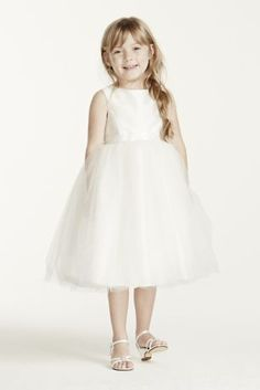 This beautiful tea length ball gown is perfect for your special flower girl!  Tankbodice features 1 inch satin ribbon sash tied at back.  Tea length tulle skirt and button back.  Fully lined. Dry clean only.