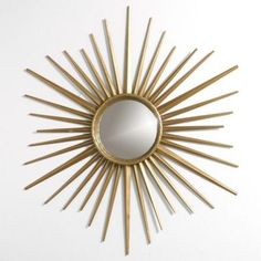 Add a ray of sunshine to your home with this Martha Stewart Living Sunburst Martha Stewart Living  mirror! No need to sacrifice style for a good value.