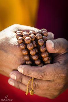 A monk holds prayer beads (Japa Mala), Bodhnath, Nepal
