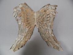 Old book and chicken wire were used to create these wings.