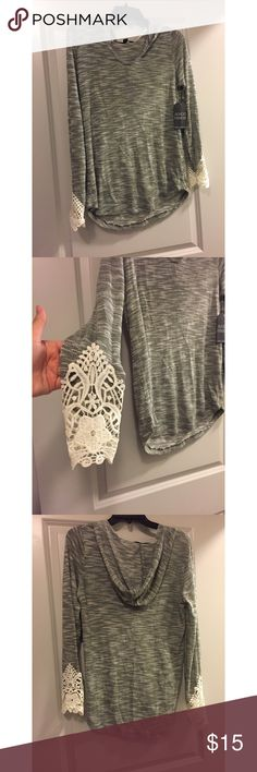 Sweater with lace ends Light sweater with lace ends. Never worn, tags still there. Bundle or make an offer. Sweaters