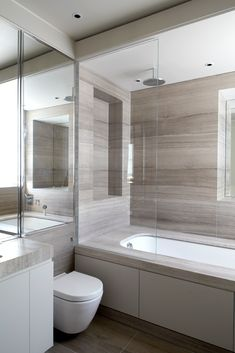 Contemporary shower surround.  Lg tile and flat cabinets. EATON PLACE