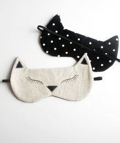 Black & White Kitty Eye Mask Perfect for sleeping in on lazy Sunday mornings! This sleeping mask is made from natural linen, with a ultra-
