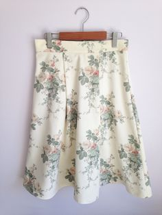A personal favourite from my Etsy shop https://www.etsy.com/uk/listing/289709859/cream-vintage-floral-pleated-skirt