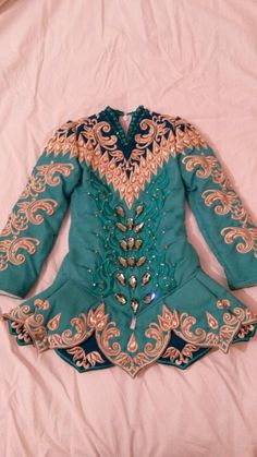 Stunning Doire dress for sale, 12 months old. Currently worn by slim under 7 championship dancer. Covered in swarovski crystals. Never been altered. Kick p [Shauna Shiels, Irish Dance Dresses, Irish Dance Dress, Solo Dress]