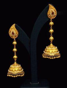 22 karat gold antique finish jhumkas. Weight: 35 grams