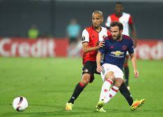 Juan Mata of Manchester United is put under pressure by Karim El Ahmadi of…