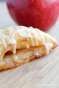 Apple Turnovers with Vanilla Glaze - Love Grows Wild - Apple Turnovers. The turnovers are super easy to make. The Puff Pastry bakes up beautifully with lo - Apple Turnover Recipe, Turnover Recipes, Apple Recipes, Fall Recipes, Baking Recipes, Just Desserts, Delicious Desserts, Yummy Food, Breakfast Recipes