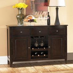 Finished in a beautiful Merlot color, this elegant wood server features room for up to six wine bottles as well as cabinets and drawers. With an elegant display in the center for your wine bottles and glasses, this server is perfect for your home.