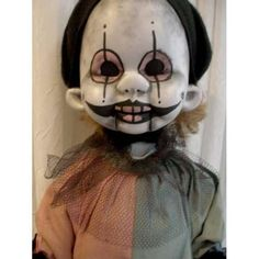 This one kills two birds with one stone.  I don't like clowns and I don't like creepy little dolls.