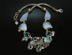 We made this octopus necklace in sterling silver with aquamarine, blue topaz, lavender chalcedony, rainbow moonstones, and sapphires and got a lot of responses so we'll make another similar one of these days. Octopus Jewelry, Mermaid Jewelry, Diy Jewelry, Jewelry Accessories, Jewellery, Blue Topaz, Aquamarine Blue, Custom Jewelry Design, Wearable Art