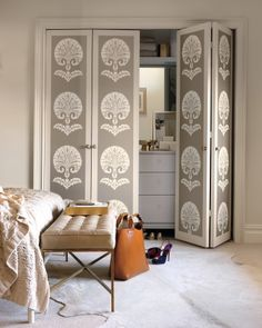 Wallpaper Paneled Doors: makes boring accordian doors look cool and intentional. Having the extra cosmetic knobs helps a lot.