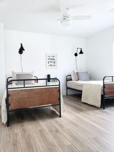 @whitelanedecor #whitelanedecor Beddy's Bed, twin trundle beds, black swing arm wall sconce, neutral bedroom, basement bedroom, black metal twin beds, side by side black metal twin beds, zipper bedding, Beddy's Oh So Boho. Basement Ideas.