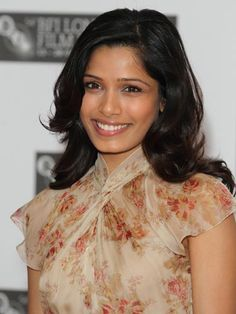 COLOR: This very dark, almost-black haircolor looks gorgeous with Freida Pinto's skin tone.