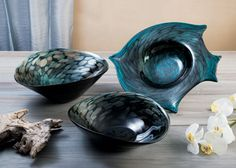 Old World glassmaking techniques are incorporated in the creation of the Abalone Blue series of handmade bowls and platters by Dynasty Gallery.
