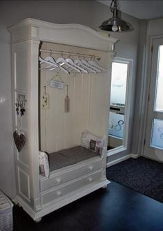 ***Great idea for a re-purposed armoire!*** I can turn my huge Ethan Allen Armoire  into a hall tree or mudroom bench.