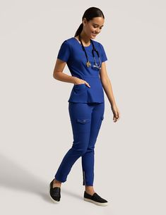 Peplum Top in Galaxy Blue is a contemporary addition to women's medical scrub outfits. Shop Jaanuu for scrubs, lab coats and other medical apparel. Stylish Scrubs, Cute Scrubs, Scrubs Outfit, Medical Uniforms, Medical Scrubs, Scrub Pants, Character Outfits, Peplum, Lab Coats