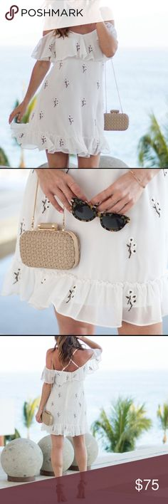 """White floral mini dress White floral dress with ruffle hem and cross cross back. 29"""" center front length (size Medium) Hidden back-zip closure V-neck Spaghetti straps Elbow sleeves Lined 100% polyester Hand wash, dry flat Willow & Clay Dresses Mini"""
