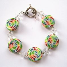Rainbow Polymer Clay Bracelet - the crystals look like the wrapper ends for the candies!