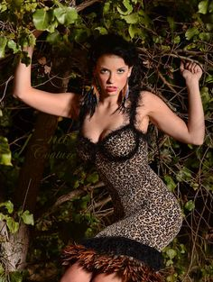 """Here was an amazingly fun Photo Shoot that we did with Amie Hanna, one of our home town Chicago's best photographer. Her creativity and ability to work with the models and inspire awesome poses is just astonishing. In this photo she had Melrose up in a tree, and it was pitch black at night with her specialized equiptment doing all these fierce leopard poses, we didn't know what was goin on, but it was so fun and the photos turned out amazing! This design is called, """"The spotted bird of prey!..."""