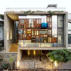 S+PSARCHITECTS adds recycled doors and windows to this mumbai house façade taken…