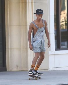 Jaden Smith Wears Denim Overall Shorts, Stance Harley Davidson Socks, Balabasas Hat And Vans Sneakers