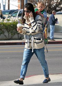 Selma Blair sipped a chilled coffee drink and chatted on the phone carrying son Arthur (munching an apple!)