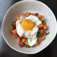 Sweet potato hash made with bacon, green onions, and a green bell pepper. Top with a sunny side egg to add an extra layer of creaminess to this easy to make brunch recipe.