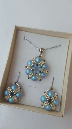 Handmade beaded necklace pendant and earrings. Made with seed beads and pearls