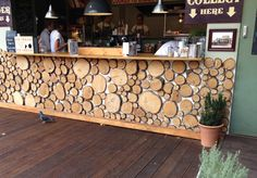 Tree Trunk circles for decoration. Could use these around the windows to cover the Turkish arcs? Bar Ideas, Decor Ideas, Man Store, Pub Decor, Home Decor, Circle Bar, Wedding Lounge, Wood Circles, Beach Bars