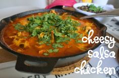 cheesy salsa chicken - chicken thighs browned in a hot pan, smothered in salsa, shredded, and then sprinkled with cheese. delicious alongside rice & beans or inside of a taco or burrito. leftovers are perfect for hash the next morning.