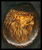 'Main Lion' - Male lion burn on a tagua slice. This was the first piece of burning I did on tagua. I've kept this one myself. NFS