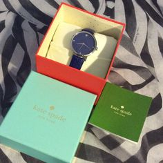 Kate Spade Blue Leather Watch Beautiful blue, genuine leather Kate Spade watch. Worn twice. Battery needs replaced and there is some circular marks on the face, that aren't very noticeable when wearing (in third picture). Face measures 1.25 inches across. Comes with Kate Spade watch box. Guaranteed authentic. kate spade Accessories Watches