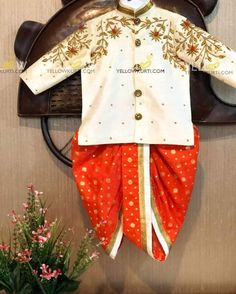 Beautiful white color kids kurti and orange color paijama. Kurti with floral design hand embroidery thread work. Indian Dresses For Kids, Kids Indian Wear, Kids Ethnic Wear, Dresses Kids Girl, Baby Dresses, Baby Boy Suit, Baby Boy Dress, Mom And Son Outfits, Kids Outfits