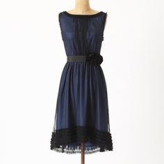Moulinette Soeurs blue dress with black overlay Stunning blue dress with delicate layer of black mesh. Sweet ruffles adorn the neck, arms and hem with a little bit of blue lace peeking through the bottom. Black ribbon belt with rosettes at hip.  Like new! Anthropologie Dresses
