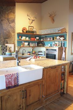 Loving those cabinets with the apron sink. I think we'd go for a lighter countertop, though...I'm seriously considering honed marble